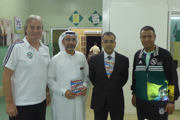Peter Schreiner (left), Mr Yousef Fares, director of boys school, Mr Zayed Al Henawi and Mr. Mohamed Afifey